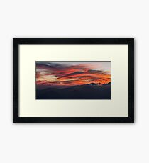 Red clouds in the sky at sunset Framed Print