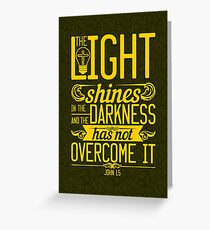 The light shines in the darkness, and the darkness has not overcomeit. Greeting Card