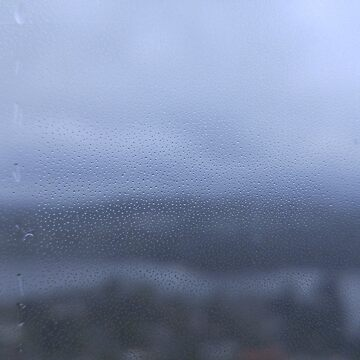 Rain water droplets on glass with out-of-focus landscape background by LaunchMission