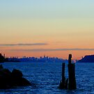 New York City skyline over the Hudson river during sunset  by Vitaliy Gonikman