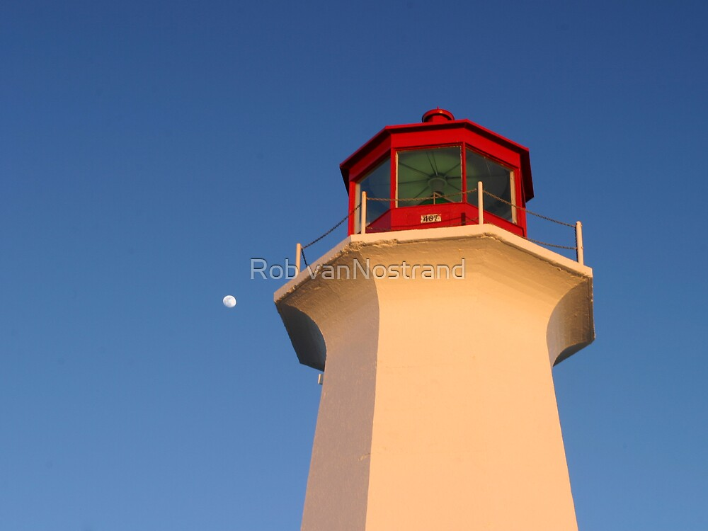 Moon rising over head of Peggys Cove Lighthouse by Rob vanNostrand