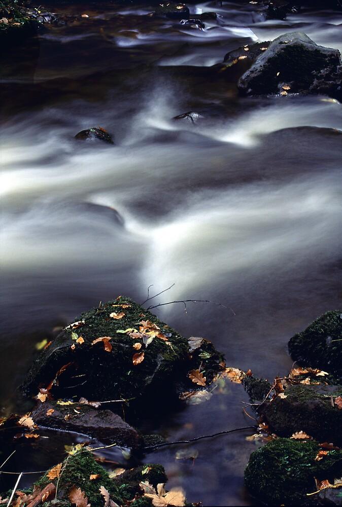 Swirling Water in Rock Pools by kitlew