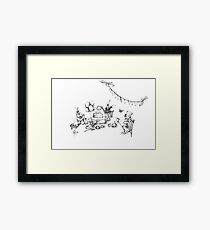 Why is a Raven like a Writing Desk? Framed Print
