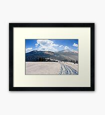 agricultural field with haystack on hillside in winter  Framed Print