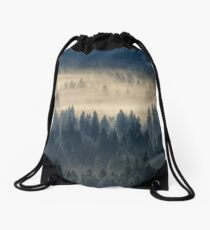 coniferous forest in foggy mountains Drawstring Bag