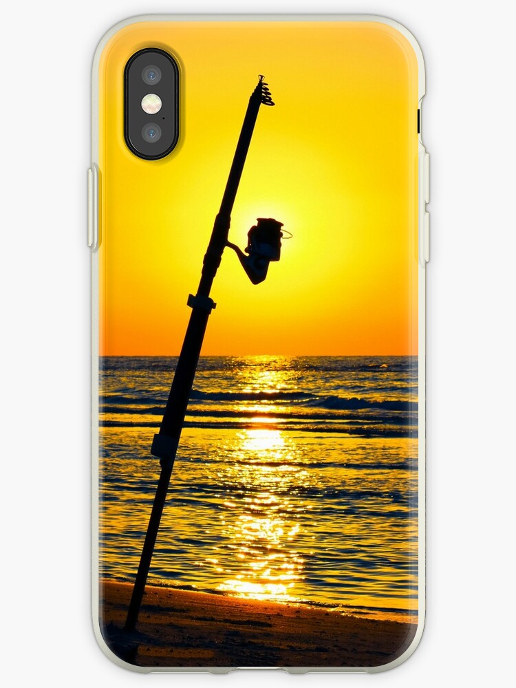 A fishing rod on the shore at sunset  by PhotoStock-Isra