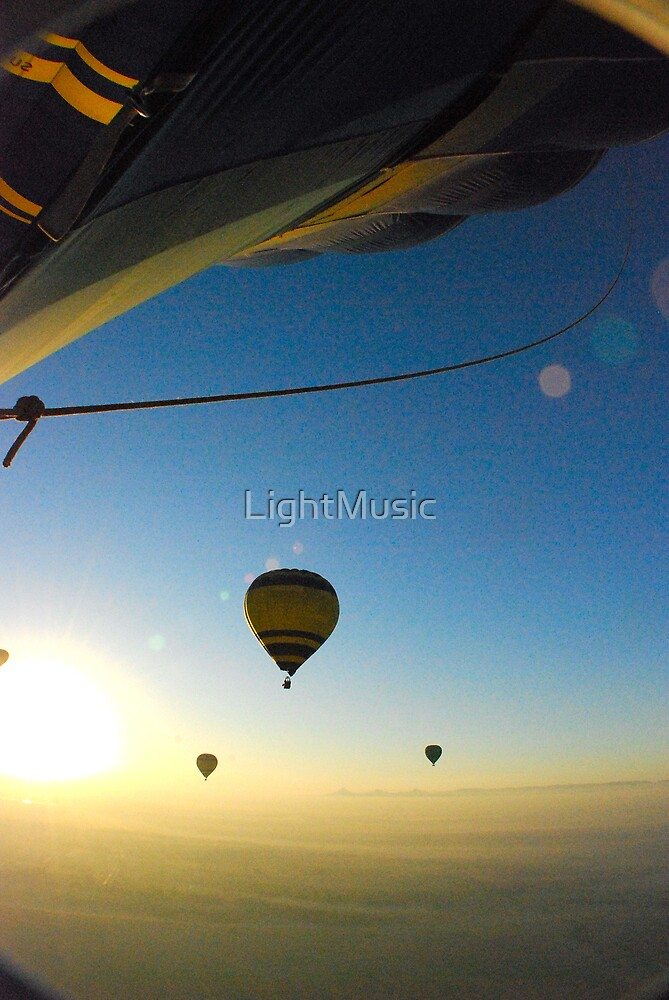 Balloons at sunrise by LightMusic