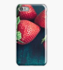 Fresh strawberries on a textured dark green board. Close-up. iPhone Case/Skin