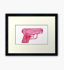 Water Gun Framed Print