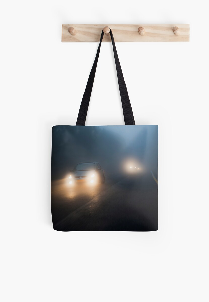 Car headlights driving in heavy mist  by PhotoStock-Isra