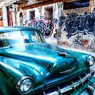 Old green American car on the streets of Havana Cuba by Paul Thompson Photography