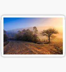 road in rural area at sunrise Sticker