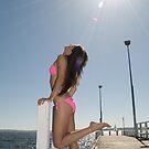 Flirty model soaking up the summer sun by palmerphoto