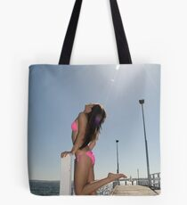 Flirty model soaking up the summer sun Tote Bag