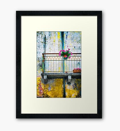 Geraniums on balcony Framed Print