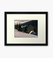 woodshed on the hillside in winter mountains Framed Print