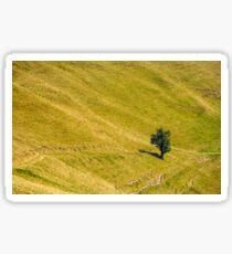 few trees on a mountain hill side Sticker
