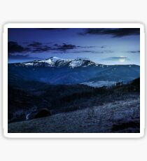 agricultural field with haystack on hillside at night Sticker