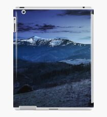 agricultural field with haystack on hillside at night iPad Case/Skin