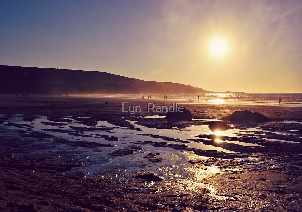 Beach at Sunset. by Lyn  Randle