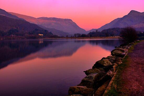 Tranquil mountain sunset by nayamina