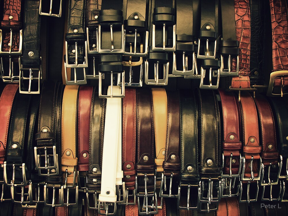 Belts at a Florence bazaar by Peter L
