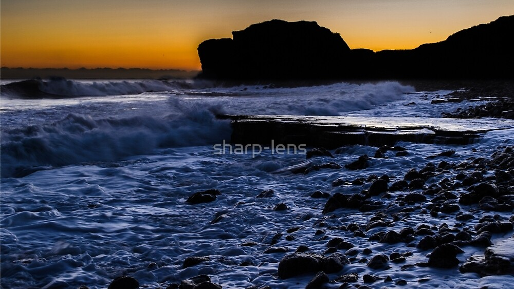 Sunrise behind cliff by sharp-lens