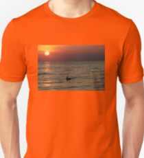 PEACEFUL PELICAN ON THE OCEAN AT DUSK Unisex T-Shirt