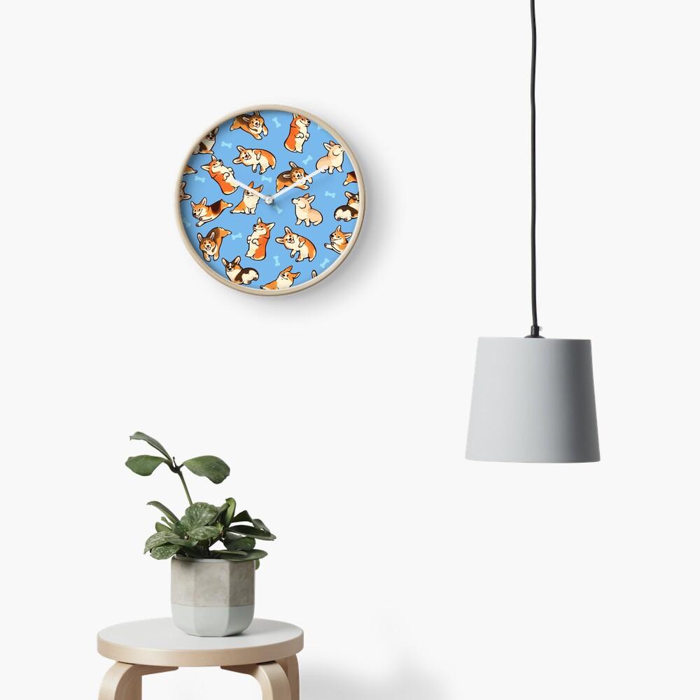 Jolly corgis in blue Clock