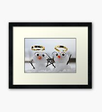 Two cute snowman angles with golden halos Framed Print