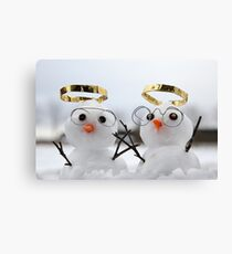 Two cute snowman angles with golden halos Canvas Print