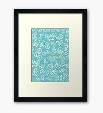 Bikes in a blue turquoise background Framed Print