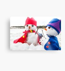 Two cute snowmen dressed as kings  Canvas Print