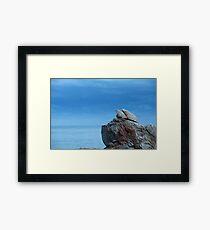 Rock against the sea Framed Print
