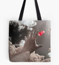 I chase it here, I chase it there, that damned elusive red bubble Tote Bag