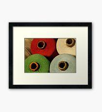 colorful tailor thread on bobbins Framed Print