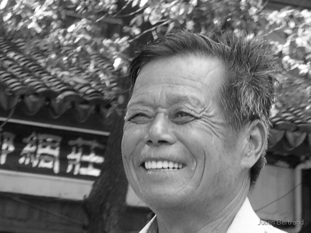 Chinese man smiling by Julien Bertrand