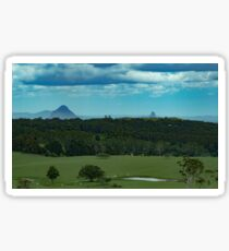 Distant mountain farmlands Sticker