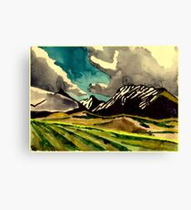 Fields and mountains and a sky Canvas Print