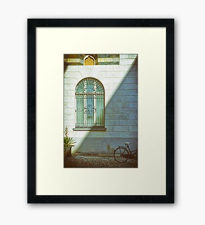 Window, shadow and bicycle Framed Print