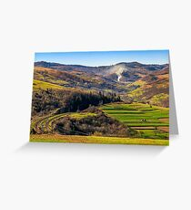 Rail road winds through mountainous rural area Greeting Card