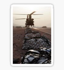 Marines attach sling loads to the body of an Army CH-47 Chinook cargo helicopter. Sticker