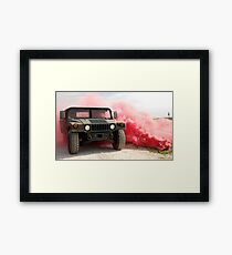 Red smoke billows out onto a humvee. Framed Print