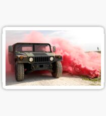 Red smoke billows out onto a humvee. Sticker