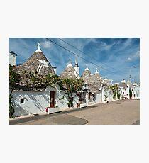 Trulli houses in the shopping street in Alberobello, Puglia, Italy Photographic Print
