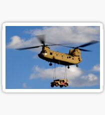 A U.S. Army CH-47 Chinook helicopter transports a Humvee. Sticker
