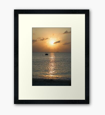 Sun setting over departing cruise ship Framed Print