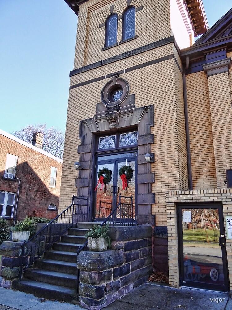 Wreaths on the church door by vigor