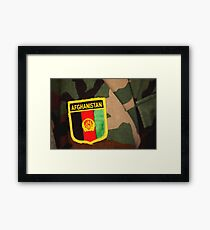 Close-up view of a patch sewn onto the arm of a soldier's uniform. Framed Print
