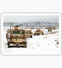 A convoy of vehicles during a route clearing procedure in Afghanistan. Sticker